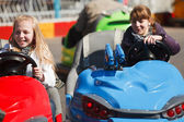 Teenage girls driving a bumper cars — Stock Photo