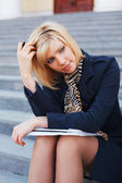 Young businesswoman with a notebook — Stock Photo
