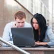 Young couple using laptop — Stock Photo #8470569