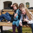 Teenage schoolgirls relaxing on campus — Foto Stock #8470626