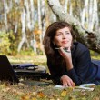 Young businesswoman working on nature — Stock Photo