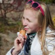 Teenage girl with an ice cream - Stok fotoğraf