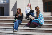 Teenage schoolgirls on the steps — Stock Photo