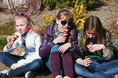 Teenage girls eating an ice cream — Stock Photo