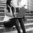 Young woman using laptop — Stock Photo