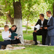 Young business in a city park — Stock Photo #8683964