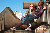 Teenage girls relaxing on a city street — Stock Photo