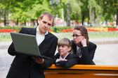 Young business with laptop — Stockfoto