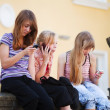 Stock Photo: Teenage girls calling on mobile phones