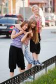 Teenage girls on a city street — Stock Photo