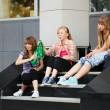 Stock Photo: Teenage girls relaxing on a school steps