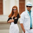 Young couple on a city street — Stock Photo