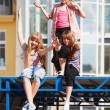 Stock Photo: Teenage girls relaxing on a city street