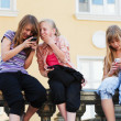 Stock Photo: Teenage girls calling on the mobile phones