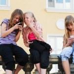 Teenage girls calling on the mobile phones — Stock Photo