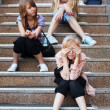 Teenage girls relaxing on a steps — Stock Photo