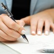 Businesswoman signing contract — Stock Photo