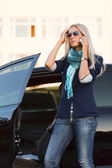 Female driver calling on the phone — Stock Photo