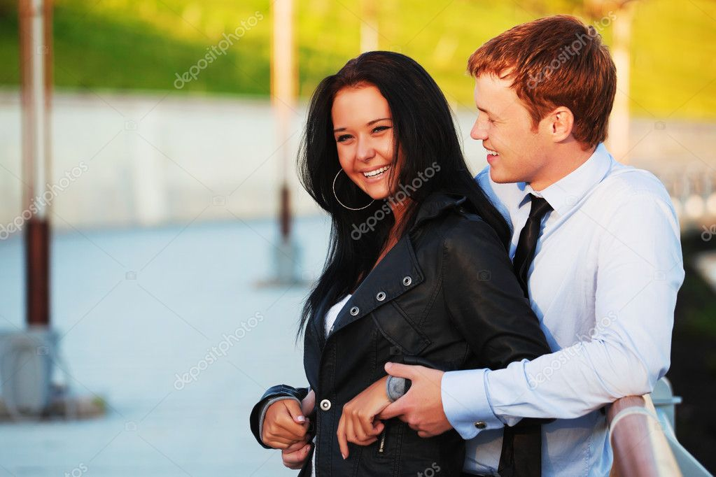 Happy young couple on a city street.  Stock Photo #9456731