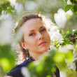 Stock Photo: Beautiful woman in a spring garden