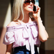 Young woman on the phone — Stock Photo #9625534