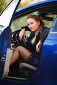 Woman in a sports car — Stock Photo