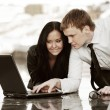 Stock Photo: Young business couple using laptop