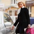 Young shopper with a car — Stock Photo