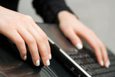 Female hands using laptop — Stock Photo