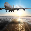 Passenger airplane landing on runway in airport. - Stock Photo