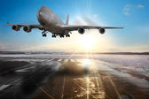 Passenger airplane landing on runway in airport. — Stock Photo