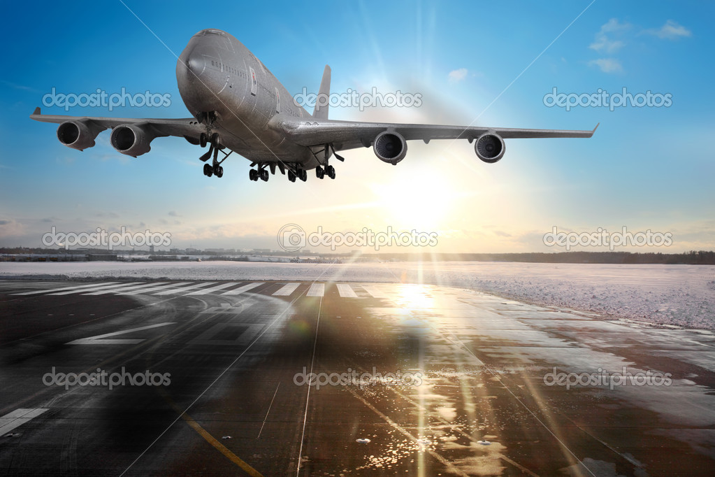 Passenger airplane landing on runway in airport.  Stock Photo #10076754