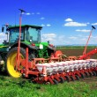 Tractor plowing the fields in early spring. — Stock Photo #10451679