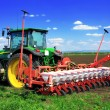 Tractor plowing the fields in early spring. — Stock Photo #10500765
