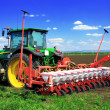 Stock Photo: Tractor plowing fields in early spring.