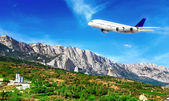 Modern airplane in South part of Crimea. — Stock Photo
