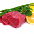 Cut of  beef steak  with lemon slice and onion. - Stock Photo