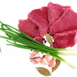 Stock Photo: Cut of beef steak with laurel, onion, garlic and flavouring.