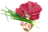 Cut of beef steak with laurel, onion, garlic and flavouring. — Stock Photo