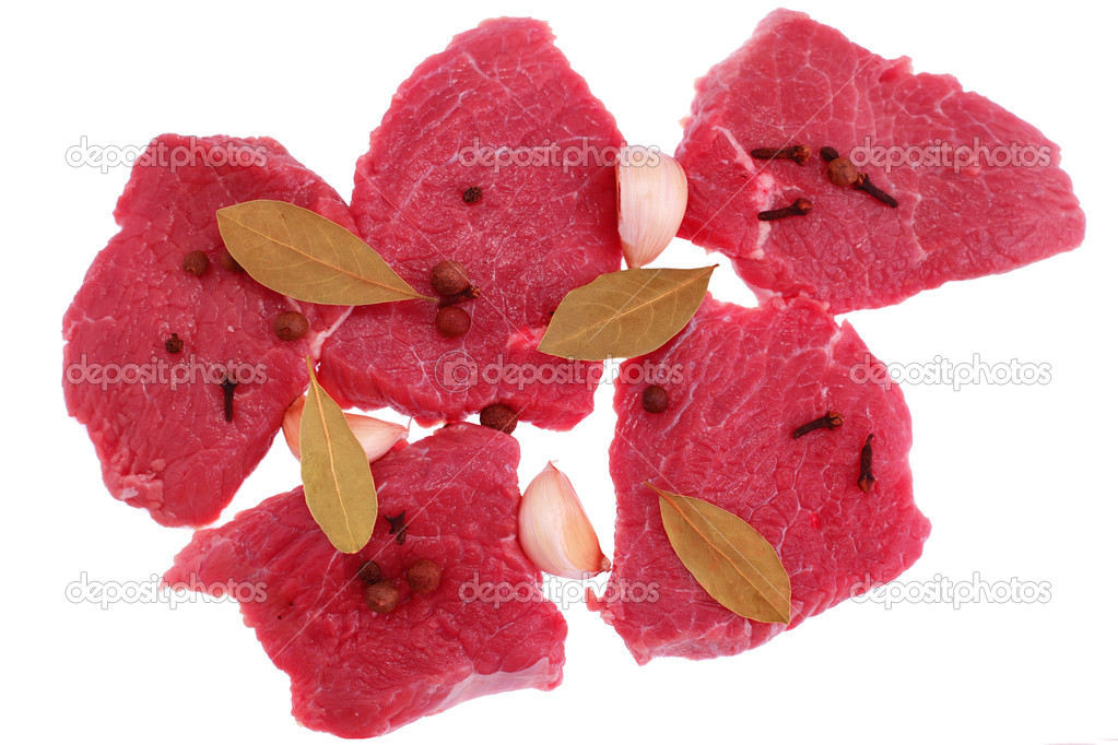 Cut of  beef steak  with  laurel, garlic and  flavouring. Isolated.  Stock Photo #8090336