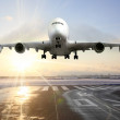 Stock Photo: Passenger airplane landing on runway in airport.