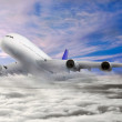 Modern airplane  in the sky near Airport. — Stock Photo