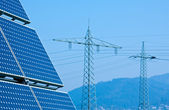 Solar Panel and High Voltage Tower — Stock Photo
