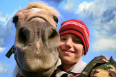 Boy and horse — Stock Photo