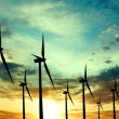 Stock Photo: Wind turbines farm at sunset