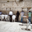 Jews at the wailing western wall in Jerusalem - Stock Photo