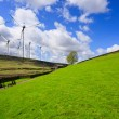 Green hill and turbine — Stock Photo