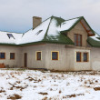 House under construction in winter scenery - Lizenzfreies Foto