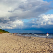 Beach and cloudy sky - Stock Photo
