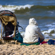 Mother and baby carriage on the beach — Stockfoto